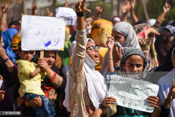 Kashmir residents chant slogans while making gestures during the protest Hundreds of people have held a street protest in Kashmir as Indias...