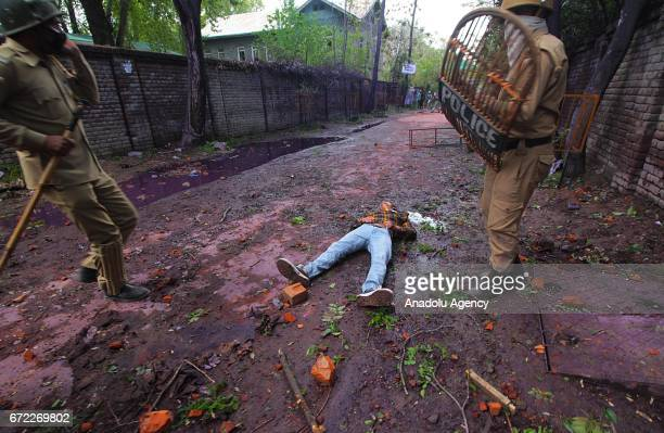 Kashmir youth lies unconscious after being hit on his head with unknown object during clashes among students and Indian police in Srinagar the summer...