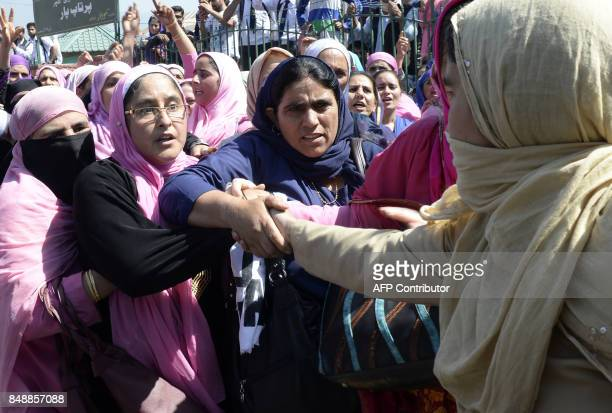 Kashmiri 'Anganwadi' a government sponsored child and mother care workers scuffle with Indian police during an antigovernment protest in Srinagar on...