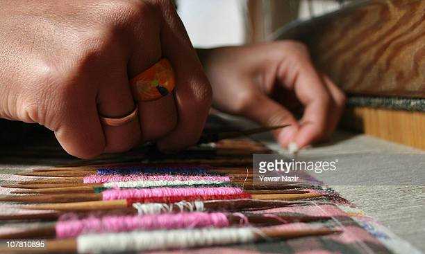 Kashmiri artisan works on a woven Kani or Jamewar shawl at his workshop on December 29 2010 in the outskirts of Srinagar the summer capital of Indian...