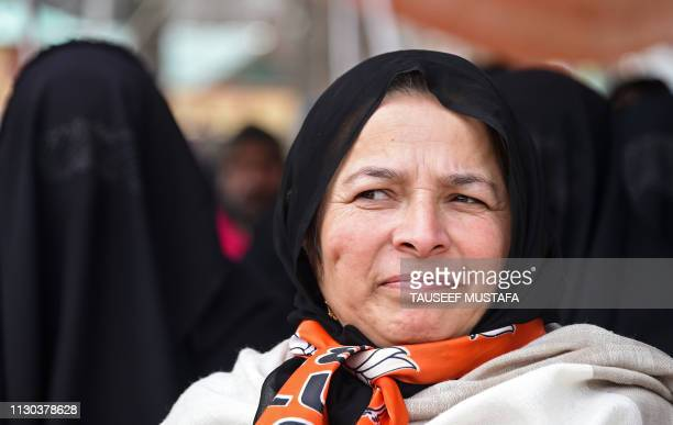 Kashmiri Bhartiya Janata Party activist looks on as she attends a party workers convention ahead of the upcoming general elections in Srinagar on...