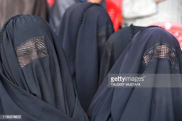 Kashmiri Bhartiya Janata Party activists wearing burqa attend a party workers convention ahead of the upcoming general elections in Srinagar on March...