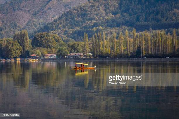 Kashmiri boatman paddles a shikara across Dal lake on October 20 2017 in Srinagar the summer capital of Indian administered Kashmir India Kashmir the...