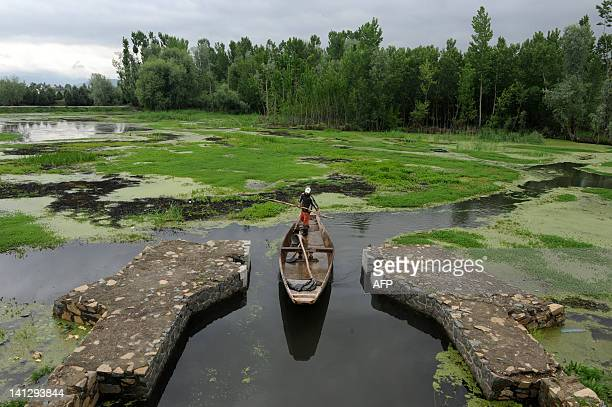Kashmiri boatman paddles a vessel across Dal Lake in Srinagar on April 21, 2010. Earth Day is a day designed to inspire awareness and appreciation...