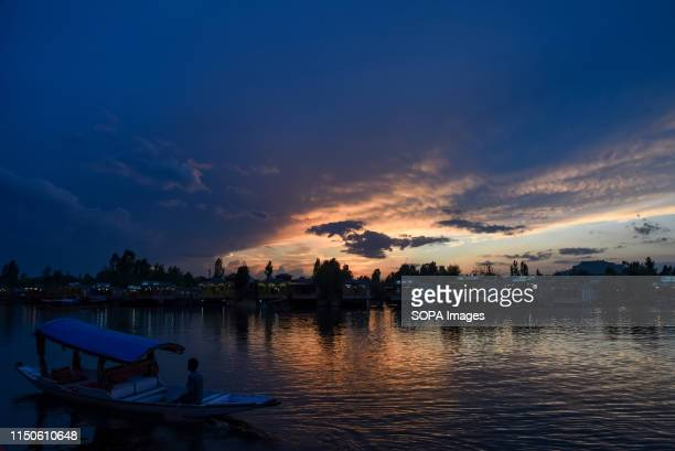 Kashmiri boatman rows his boat on the waters of Dal lake during sunset in Srinagar summer capital of Indian administered Kashmir.