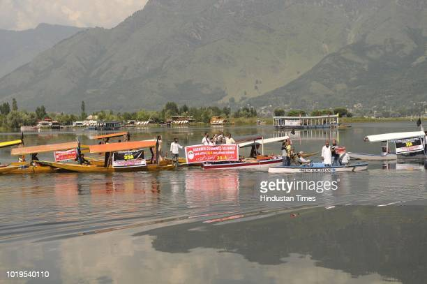 Kashmiri boatmen during a boat rally on the water Dal Lake as a mark protest against challenging of Article 35A on August 19 2018 in Srinagar India