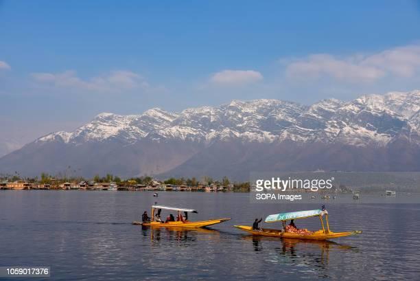 SRINAGAR JAMMU KASHMIR INDIA Kashmiri boatmen seen rowing their boats on waters of Dal Lake in Srinagar during the autumn season Kashmir has been...