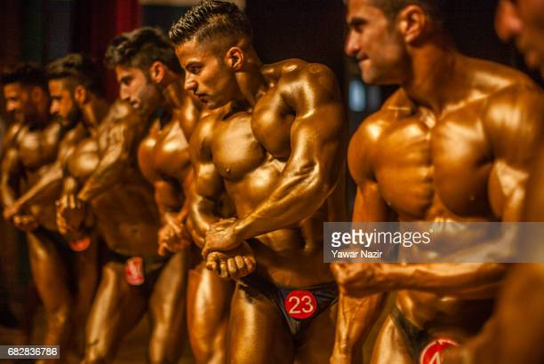 Kashmiri body builders strike a pose during the 'Mr Kashmir Body Building Competition' organized by Jammu and Kashmir Bodybuilding Association on May...