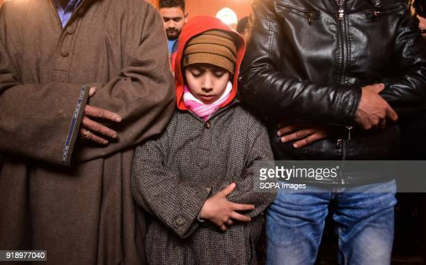 Kashmiri boy offer Friday prayers inside the Grand Mosque in Srinagar Indian administered Kashmir The weekly prayers Friday were allowed in the Grand...
