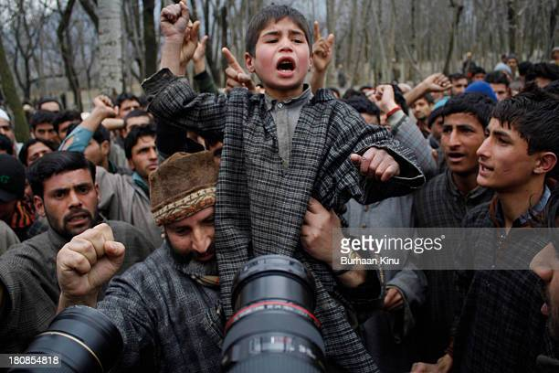 Kashmiri boy shout pro-freedom slogans near the body of 20 year old student Manzoor Ahmad Wagay shot on February 4 by Indian troops in Chogul...