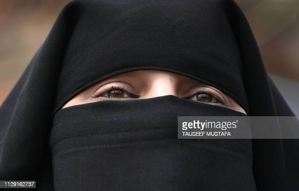 Kashmiri burqa-clad woman is pictured during a strike in Srinagar's Maisuma area on March 8 against the detention of Jammu and Kashmir Liberation...