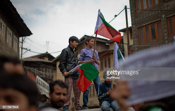 Kashmiri children hold flags as the leaders and activist of the Jammu Kashmir Liberation Front a Kashmir resistance party fighting politically for...