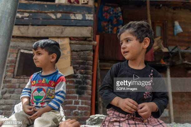 Kashmiri children look on as they pose for a picture in Dawar, Gurez. Gurez lies along the LOC in northern part of Kashmir. The people in Gurez are...