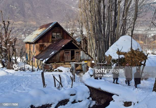 Kashmiri children seen walking through snow during a sunny winter day in Ganderbal about 50kms from Srinagar Indian administered Kashmir The valley...
