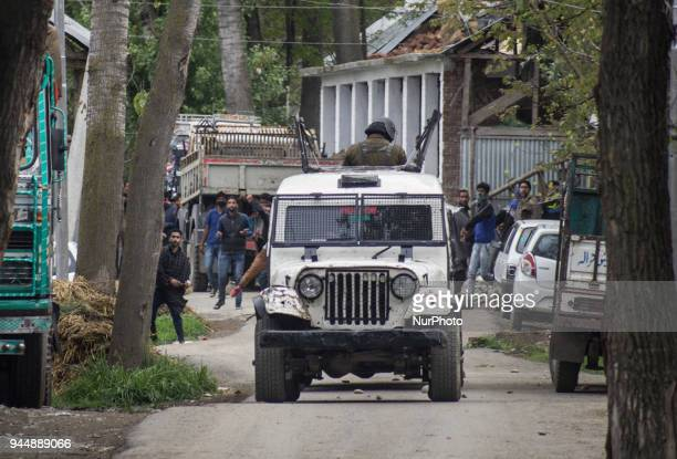 Kashmiri civilians clash with the government forces near the gunfight site Wednesday April 11 in Khudwani village about 60 kilometres south of...