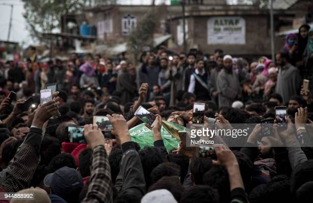 Kashmiri civilians click pictures of the body of Sharjeel Sheikh a civilian who was shot dead by Indian government forces during clashes near the...