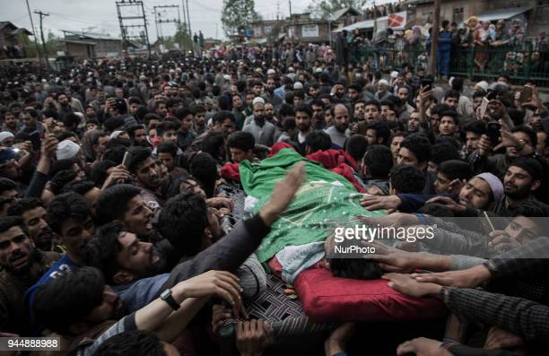Kashmiri civilians offer funeral prayers to Sharjeel Sheikh a civilian who was shot dead by Indian government forces during clashes near the gunfight...