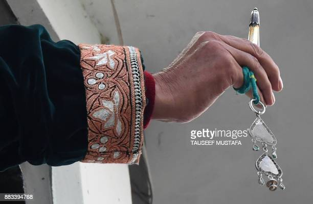 A Kashmiri cleric displays a holy relic believed to contain a hair from the beard of Prophet Muhammed during EideMiladunNabi the birthday of the...