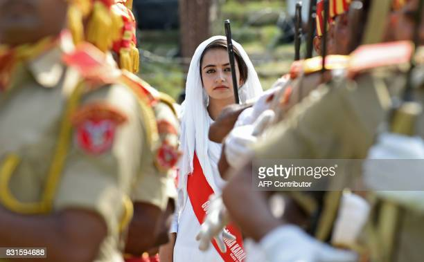 A Kashmiri colleage girl looks on during celebrations marking India's Independence Day at Bakshi Stadium in Srinagar on August 15 2017 India...