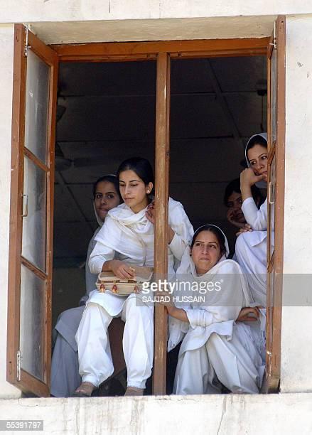 Kashmiri college girls watch a women's cricket match from a class room at the Women's College in Srinagar 13 September 2005 The Indian Women's...