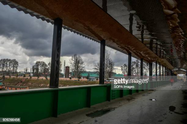 Kashmiri commuters walk on a partly cloudy day in Srinagar Indian administered Kashmir Ahead of prediction of rain and snow from Thursday due to a...