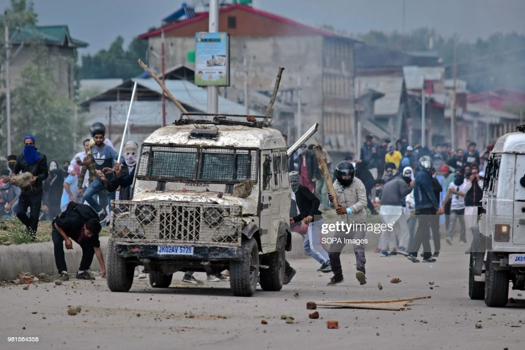 kashmiri demonstrators attack an armoured vehicle during pictures