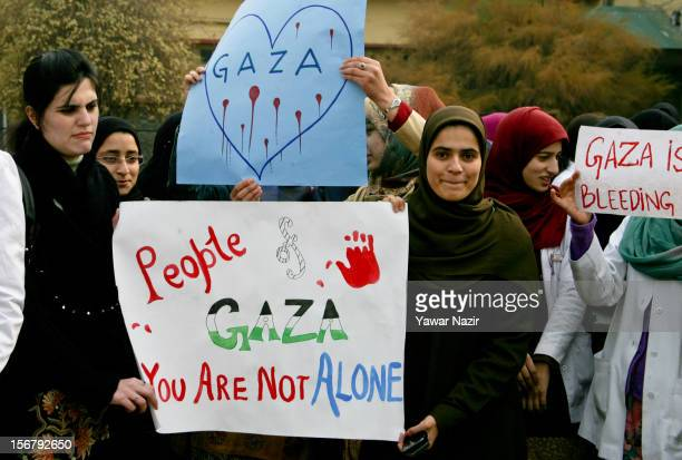 Kashmiri doctors hold banners and placards during a protest against Israel and in solidarity with Gaza at SMHS medical college on November 21 2012 in...