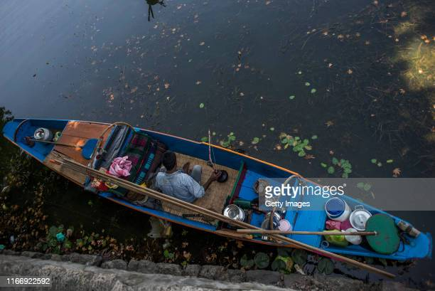 Kashmiri fisherman sits in his boat at Dal lake during curfew like restrictions on September 09 2019 in Srinagar the summer capital of Indian...