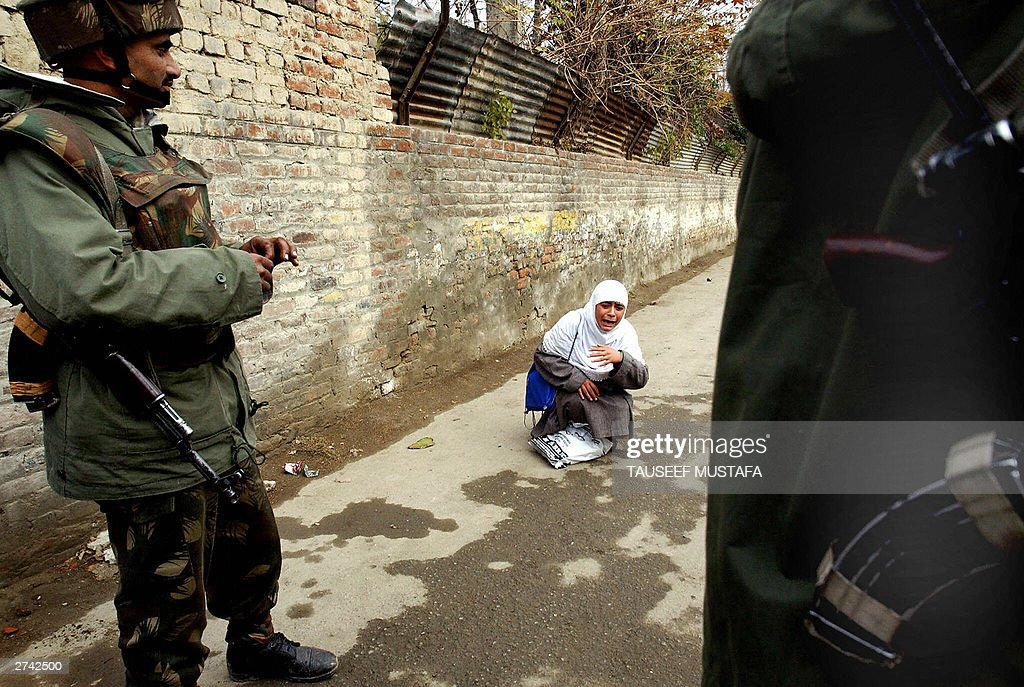 A Kashmiri girl cries as she is stopped  : News Photo