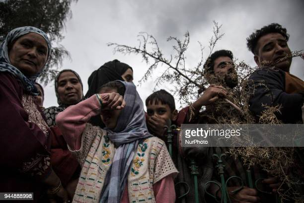 A Kashmiri girl cries during the funeral procession of a civilian Sharjeel Sheikh a civilian who was shot dead by Indian government forces during...