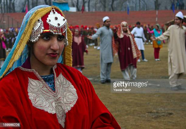 A kashmiri girl in traditional Kashmiri attire practices during their final full dress rehearsal for the Republic Day parade at Bakshi Stadium on...