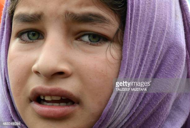 Kashmiri girl mourns during a funeral for an alleged Lashker-e-Toiba militant in Kakapora, south of Srinagar, on August 7, 2015. One militant was...