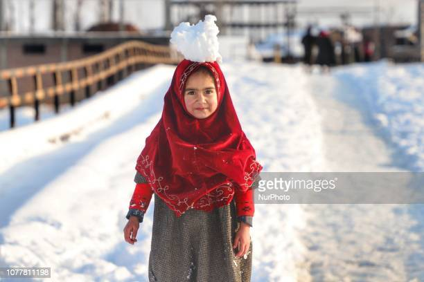 A Kashmiri Girl plays with snow in Sopore town of District Baramulla Some 55 Kms from SrinagarIndia on 5th January 2019