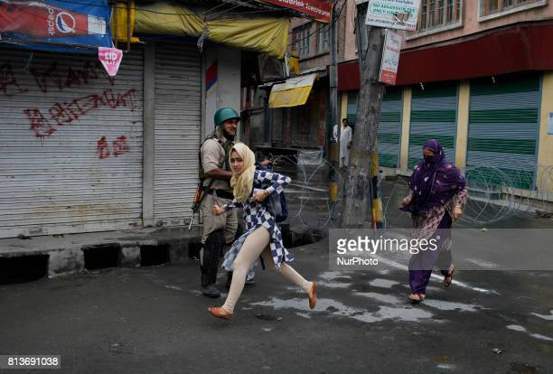 A kashmiri girl runs for cover during clashes in old city srinagar on july 12 2017AntiIndia protests and clashes erupted in the main city Srinagar...