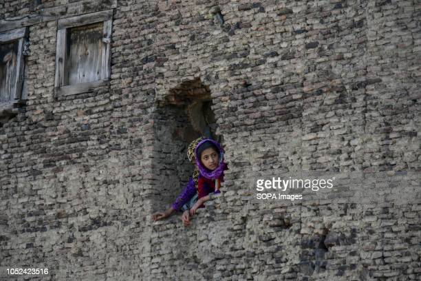 Kashmiri girl seen watching the street protests Clashes broke out between militants and government forces in Srinagar The government forces cordoned...
