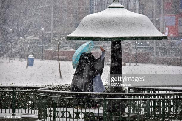 Kashmiri girls seen taking a selfie in a park during heavy snowfall in Srinagar Indian administered Kashmir Fresh snowfall began in Kashmir valley...
