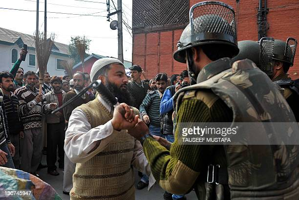 Kashmiri government employees shout anti-government slogans as they scuffle with Indian police during a protest in Srinagar on October 29, 2011....