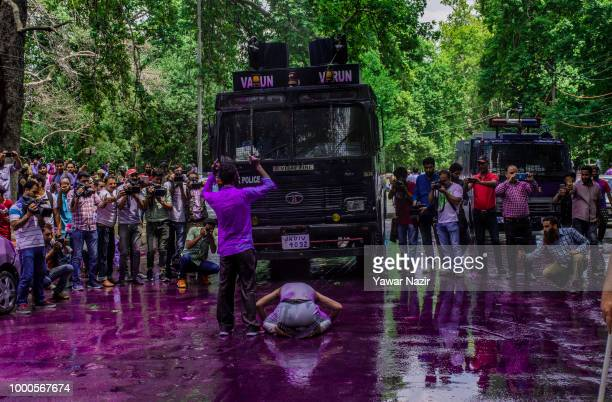 Kashmiri government teacher dares Indian police water canon during a protest against the government on July 17 2018 in Srinagar the summer capital of...