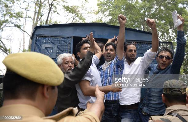 Kashmiri government teachers shout anti government slogans inside a police vehicle after been detained by Indian police during a protest in Srinagar...