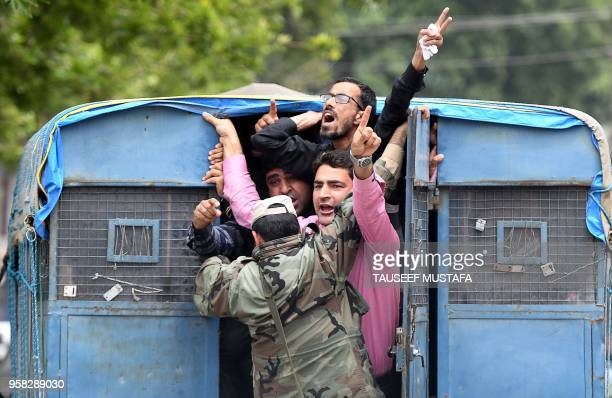 TOPSHOT Kashmiri government teachers shout anti government slogans inside a police vehicle after been detained by Indian police during a protest...
