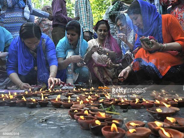 Kashmiri Hindu devotees light earthen lamps during the annual Hindu festival at the Kheer Bhawani Temple at Tullamulla Ganderbal, some 28 Km...
