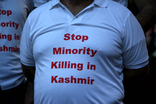 Kashmiri Hindu, known as Pandit, wears a t-shirt reading 'Stop Minority Killing in Kashmir' during a protest against the recent targeted killings of...