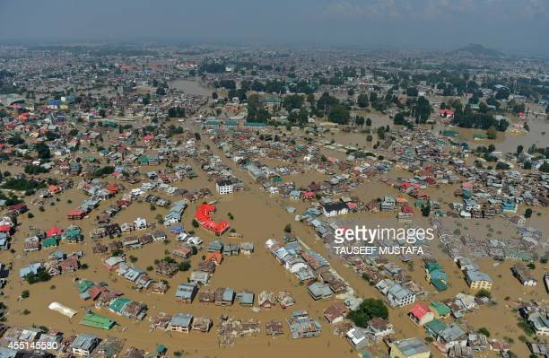 Kashmiri houseboats and houses submerged by floodwater are seen from an Indian Air Force helicopter during rescue and relief operations in Dal Lake...