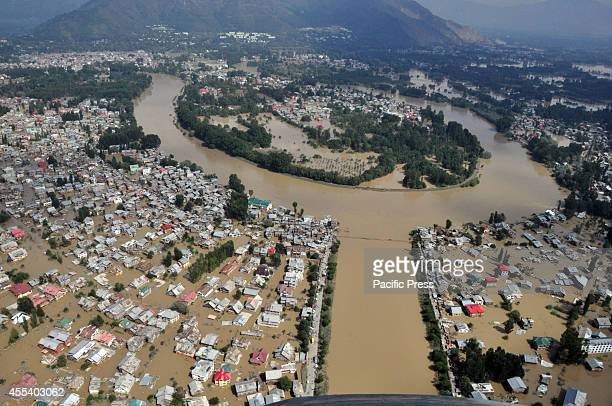 Kashmiri houses inundated by flood waters are seen from an Indian Air Force helicopter during rescue and relief operations in Srinagar The floods and...