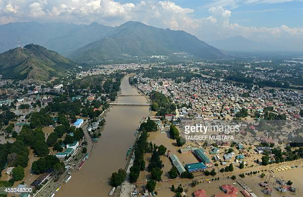 Kashmiri houses inundated by floodwaters are seen from an Indian Air Force helicopter during rescue and relief operations in Srinagar on September 11...