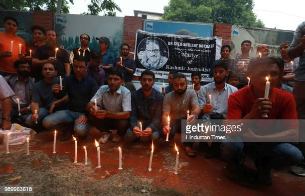 Kashmiri journalists held a candle light vigil in memory of Rising Kashmir Founder and former EditorinChief Shujaat Bukhari outside Kashmir Press...