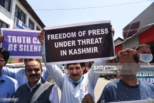 Kashmiri journalists hold placards during a protest against a new media policy that was announced last month at Press Enclave on July 6 2020 in...