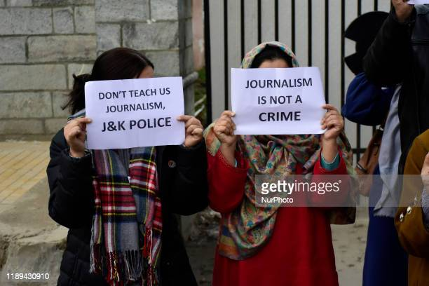 Kashmiri journalists hold placards during a protest against the high handedness of Indian forces in Srinagar Indian Administered Kashmir on 18...