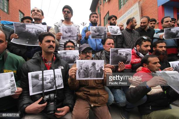 Kashmiri journalists stage protest against the manhandling of their colleagues by Indian police in Srinagar the summer capital of Indian controlled...