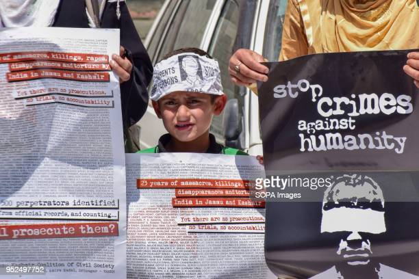 ENCLAVE SRINAGAR JAMMU KASHMIR INDIA Kashmiri kid holds placard as he participated in a protest of Association of parents of Disappeared persons In...